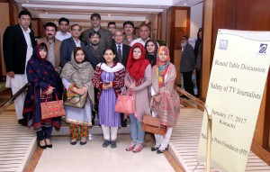 "PPF Secretary General Owais Aslam Ali in group photo with participants of workshop on ""Safety of TV Journalists."" (S. Imran Ali/PPI)"